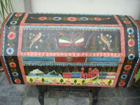 Mexican vintage folk art, and Mexican vintage woodcarvings and masks, a truly beautiful, large arcon, or trunk, of black laquered wood, with incredible artwork, Olinala, c. 1930's. Main photo of the arcon, or trunk.