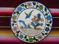 Mexican vintage pottery and ceramics, a beautiful Tlaquepaque pottery plate with a wonderful border surrounding a scene of a deer and a hummingbird, Tonala or San Pedro Tlaquepaque, Jalisco, c. 1940's. Main photo of the plate.