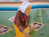 Native American Indian folk art and woodcarvings, a wonderful woodcarving of an old Navajo woman, signed by the great Navajo folk art woodcarver Johnson Antonio, Arizona or New Mexico, c. 1990. Another closer side view of the Johnson Antonio folk art woodcarving.