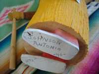 Native American Indian folk art and woodcarvings, a wonderful woodcarving of an old Navajo woman, signed by the great Navajo folk art woodcarver Johnson Antonio, Arizona or New Mexico, c. 1990. Photo of the bottom of the figure showing Johnson Antonio's signature and the date.