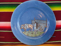 Mexican vintage pottery and ceramics, a lovely blue-glazed Tlaquepaque plate with fine artwork featuring a campesino with his faithful ox, Tonala or San Pedro Tlaquepaque, Jalisco, c. 1940's. Main photo of the plate showing the front.