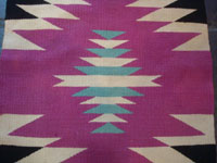 Native American Indian vintage textiles, and Navajo vintage rugs and textiles, a beautiful Navajo rug of fine Germantown woolen yarn, Arizona or New Mexico, c. 1900. A closeup photo of a central section of the textile.