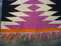 Native American Indian vintage textiles, and Navajo vintage rugs and textiles, a beautiful Navajo rug of fine Germantown woolen yarn, Arizona or New Mexico, c. 1900. A photo of one edge of the Navajo rug showing the fringe.