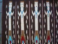 Native American Indian textiles, and Navajo textiles and rugs, a wonderful Yei-pattern textile or rug with beautiful Yei figures, Navajo, Arizona or New Mexico, c. 1970. Closeup view of a part of the Navajo Yei rug.