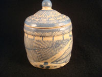 Mexican vintage pottery and ceramics, a jar with lid, signed Arias, with floral decorations, c. 1930-40. Beautiful cream colored glaze with blue floral decorations. Another view of the jar.