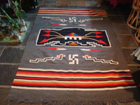 New Mexican vintage textile, a finely woven rug from the weaving center of Chimayo, New Mexico, c. 1930. This is from a very famous weaver, active from 1910-40, whose signature was the hummingbird in the center of this textile. Main photo.