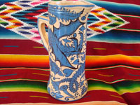 Mexican vintage pottery and ceramics, a large Fantasia-style pitcher, Tlaquepaque, c. 1930. Whimsical blue decorations on a cream-colored glaze, with dragons, flowers, leaves; all exquisitely painted. Main photo.