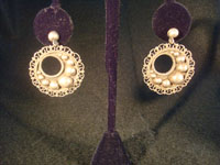 "Mexican vintage silver jewelry and vintage Taxco silver jewelry, a pair of sterling silver earrings, marked on the back ""Sterling 925"", c. 1930-40."