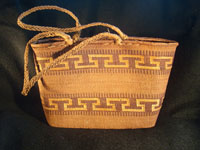 Native American Indian basket, a Northwest Coast twined purse, Tsimshian, c. 1900-10. Beautifully woven of cedar bark with geometric imbricated decoration and woven cedar bark handles. Main photo.