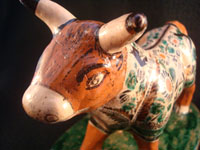 Mexican vintage pottery and ceramics, and Mexican vintage folk art, a pottery bull with fine hand-painted decoration, c. 1950. Signed on the bottom, Jose Trinidad Bernabe Lopez, Tonala, Jalisco Mexico.