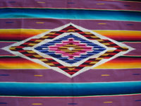 Mexican vintage textile, a wonderful Saltillo sarape, c. 1930. Very finely woven of wool with silk in the center diamond and decorative side-bars, and complete fringe. Closeup of center.