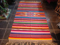 Mexican vintage textile, a wonderful Saltillo sarape, c. 1930. Very finely woven of wool with silk in the center diamond and decorative side-bars, and complete fringe. Main photo.