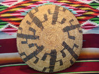 Native American Indian vintage basket, a Papago tray decorated with graceful Saguaro cacti, c. 1900. The weaving is very tight and fine, typical of earlier Papago basketry. Photo of the back side of the Papago Indian basket.