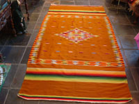 Mexican vintage sarapes and textiles, a rare and very beautiful Saltillo sarape with a tan/gold background and beautiful center medallion and rainbow border, c. 1900. Main photo of the Saltillo sarape.