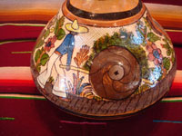Mexican vintage pottery and ceramics, a water jar attributed to the great Balbino Lucano, Tlaquepaque, Jalisco, c. 1920-30's. The jar is done in the petatillo hatchwork style (with straw-like hatchwork in the background) for which Balbino Lucano is famous. Photo of the scene of a Mexican campersino on the second side of the Tlaquepaque pottery jar.