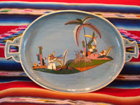 Mexican vintage pottery and ceramics, a lovely charger with a pale-blue background and excellent artwork, Tonala or Tlaquepaque, Jalisco, c. 1920-30's. The oval-shaped charger features scenes of Mexican rural life, set amidst lovely plants and foliage.  Main photo of the charger.