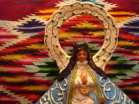 Mexican vintage pottery and ceramics, and Mexican vintage devotional art, a beautiful pottery image of Our Lady (probably Nuestra Senora de Zapopan, which is just outside of Guadalajara), Tlaquepaque or Tonala, Jalisco, c. 1930-40's. Closeup photo of the top of the Tlaquepaque pottery Madonna.