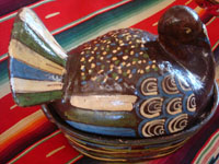 Mexican vintage folk art, and Mexican vintage pottery and ceramics, a pottery casserole with lid, in the shape of a lovely black turkey, Tonala or Tlaquepaque, Jalisco, c. 1930's. A side view of the Tonala turkey casserole.