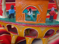 Mexican vintage folk art, and Mexican vintage pottery and ceramics, a wonderful pottery ship with happy sailors and very vibrant colors, attributed to the great Candelario Medrano or a member of his family, Santa Cruz de las Huertas, Jalisco, c. 1950's. A closeup photo showing some of the happy passengers on the Medrano pottery ship.