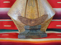Vintage Mexican devotional art, and vintage Mexican woodcarving, a very detailed and beautiful woodcarving, depicting Our Lady of Zapopan, with the signature of the very famous Cortes family of carvers, c. 1940. Closeup photo of the bottom of the woodcarving.