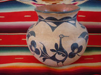 Native American Indian antique pottery, a beautiful pottery olla or vase, Santo Domingo Pueblo, c. 1900. The artwork on this olla is incredibly beautiful, with a wonderful bird and beautiful floral decorations.  Main photo.