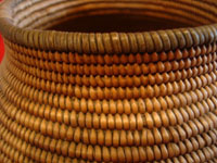 Native American Indian vintage baskets, a beautiful Chemehuevi olla with wonderful shape and decoration. c. Parker, Arizona, c. 1890-1900. Closeup photo showing the tightness of the weave of the basket.