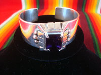 Native American Indian sterling silver jewelry, and Navajo sterling silver jewelry, a beautiful silver bracelet with a wonderful amethyst stone, signed Carl Quintana, Arizona or New Mexico, c. 1960's. Main photo of the Navajo silver jewelry bracelet.