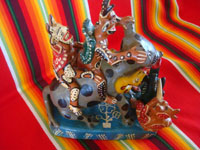 Mexican vintage folk art, and Mexican vintage pottery and ceramics, a fantastic pottery sculpture depicting a whimsical doggie being ridden by jolly devils and snakes, Ocumicho, Michoacan, c. 1960's. Another side view of the pottery sculpture.