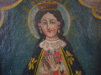 Mexican antique devotional art, and Mexican Colonial paintings and fine art, a beautiful painting of Our Lady of San Juan de los Lagos, c. 1800's.  A closeup photo of Our Lady's face.