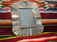 Mexican vintage tinwork art, a lovely tinwork-art mirror with a lovely design, c. 1950's. Main photo of the tinwork-art mirror.