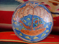 Vintage Mexican pottery and ceramics, and Mexican vintage folk art, a pair of lovely pottery plates from Tlaquepaque, c. 1920-30's. These are attributed to the famous artist, Balbino Lucano (or his equally famous brother, Tomas Lucano). Closeup photo of one of the plates.