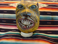 Mexican vintage wood-carving and folk art, a wonderfully carved and decorated helmet-style jaguar mask, used in dances and folk-festivals, from the Mexican state of Guerrero, c. 1950's. Main photo of the front of the Guerrero jaguar mask.