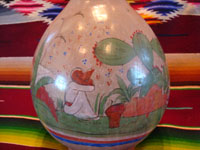 TT-3: Mexican vintage pottery and ceramics, a beautiful burnished jar from Tonala Jalisco, c. 1930's. Closeup photo of one side of the jar.