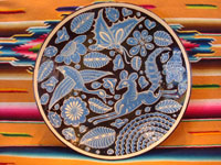 Mexican vintage pottery and ceramics, a lovely fantasia (fantasia-ware) plate with a rare black background and contrasting sky-blue design elements, Tlaquepaque or Tonala Jalisco, c. 1930's.  Main photo.