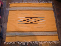 New Mexican vintage textiles, a finely woven woolen textile from Chimayo, New Mexico, with a rare mustard-colored background, c. 1940's. Main photo.