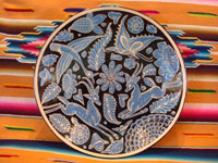 Mexican vintage pottery and ceramics, a second, very lovely fantasia plate with a rare black background and contrasting sky-blue design elements, Tlaquepaque or Tonala Jalisco, c. 1930's. Main photo.