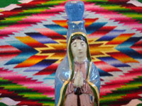 Mexican vintage pottery and ceramics, and Mexican vintage devotional art, a very fine pottery bottle depicting Our Lady of Guadalupe, Tlaquepaque or Tonala, Jalisco, c. 1930-40's. Closeup photo of the Lady's face.
