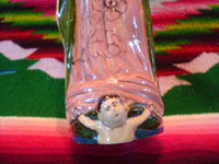 Mexican vintage pottery and ceramics, and Mexican vintage devotional art, a very fine pottery bottle depicting Our Lady of Guadalupe, Tlaquepaque or Tonala, Jalisco, c. 1930-40's. Closeup photo of the angel at Our Lady's feet.