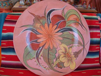 Mexican vintage pottery and ceramics, a wonderful pottery burnished charger with beautiful floral artwork and a lovely salmon background, Tonala, Jalisco, c. 1930's. Main photo of the charger.