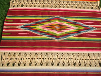 Mexican vintage textiles and serapes, a lovely Saltillo style serape with the deshilado (pulled strings) bands with lovely tenerife work, c. 1930's. Closeup photo of part of the front of the Saltillo-style runner.