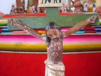 Mexican vintage devotional art, and Mexican vintage woodcarvings and masks, a very beautiful Animas Cross (a carving of the crucified Christ with two souls in purgatory near the base), c. 1930.  Closeup photo of the Christ.