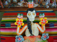 Mexican vintage folk art, and Mexican vintage pottery and ceramics, a very lovely tree-of-life, featuring a wonderful day-of-the-dead Catrina and wonderful colors, attributed to the Castillo family of Izucar de Matamoros, Puebla, c. 1950's. Closeup photo showing the Catrina's face.