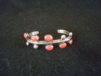 Native American Indian vintage silver jewelry, and Navajo vintage silver jewelry, a beautiful silver and coral bracelet, Navajo, c. 1930's. Main photo of the Navajo silver bracelet with coral.