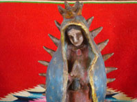 Mexican vintage devotional art, and Mexican vintage pottery and ceramics, a beautiful pottery figure of Our Lady of Guadalupe, Patroness of the Americas, Oaxaca, c. 1940. Closeup photo of Our Lady of Guadalupe's lovely face.