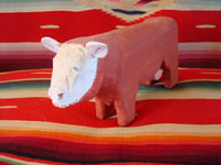 Native American Indian folk art, Navajo wood carving of a bull by Johnson Antonio, 1992.