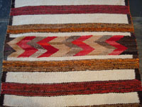 Closeup photo of center of Navajo textile with hearts.