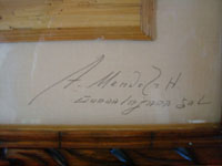 Close-up photo of the signature of the artist