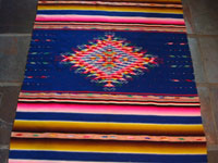 Mexican Saltillo sarape with blue background c. 1910, closeup of center diamond