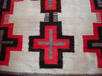 Closeup photo of Ganado Navajo rug with crosses