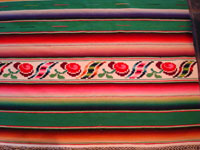 Green Saltillo sarape, closeup of end-bar with roses